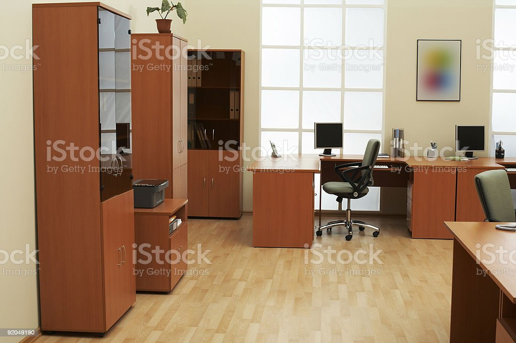 Modern wooden office desk and file cabinets royalty-free stock photo