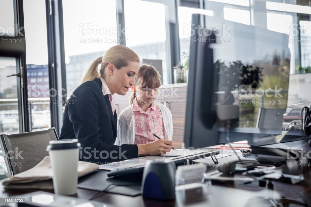 Modern working woman with child stock photo