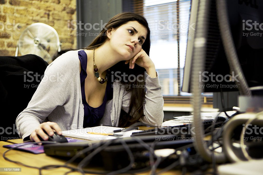modern workplace: a creative professional in concentration at her desk royalty-free stock photo