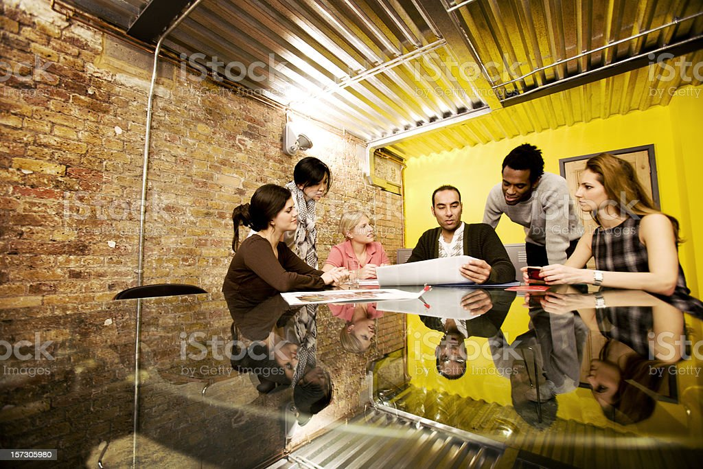 modern workplace: candid office meeting in a contemporary board room stock photo