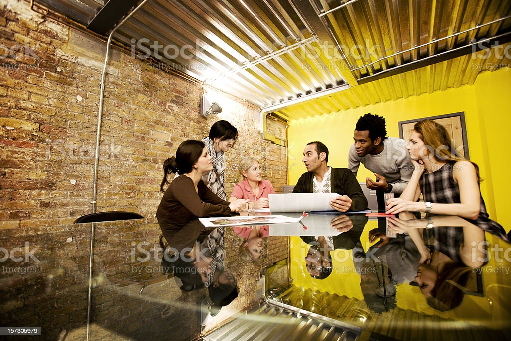 modern workplace: contemporary board room scene with diverse creative team stock photo
