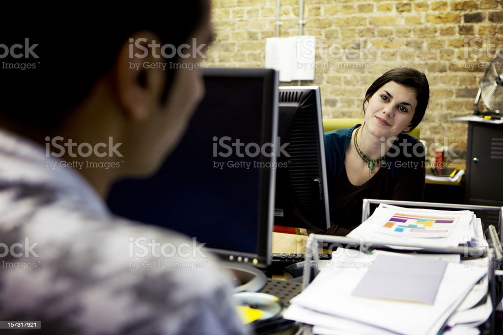 modern workplace: creative professionals working together stock photo