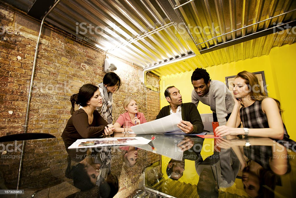 modern workplace: creative team meeting in a contemporary board room royalty-free stock photo