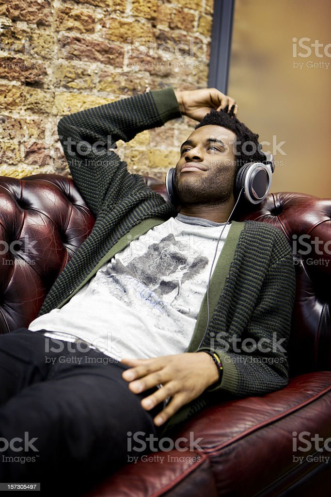 modern workplace: modern professional taking a break listening to music royalty-free stock photo