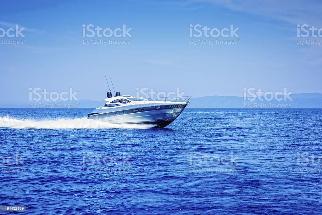 Modern yacht in motion stock photo