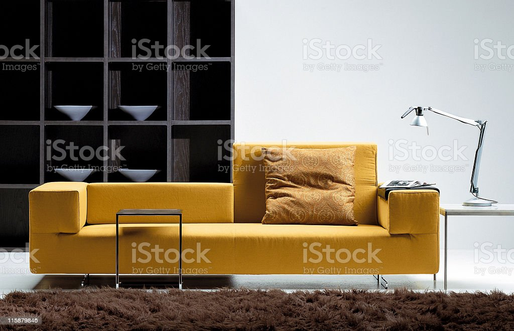 Modern yellow sofa in a living room royalty-free stock photo