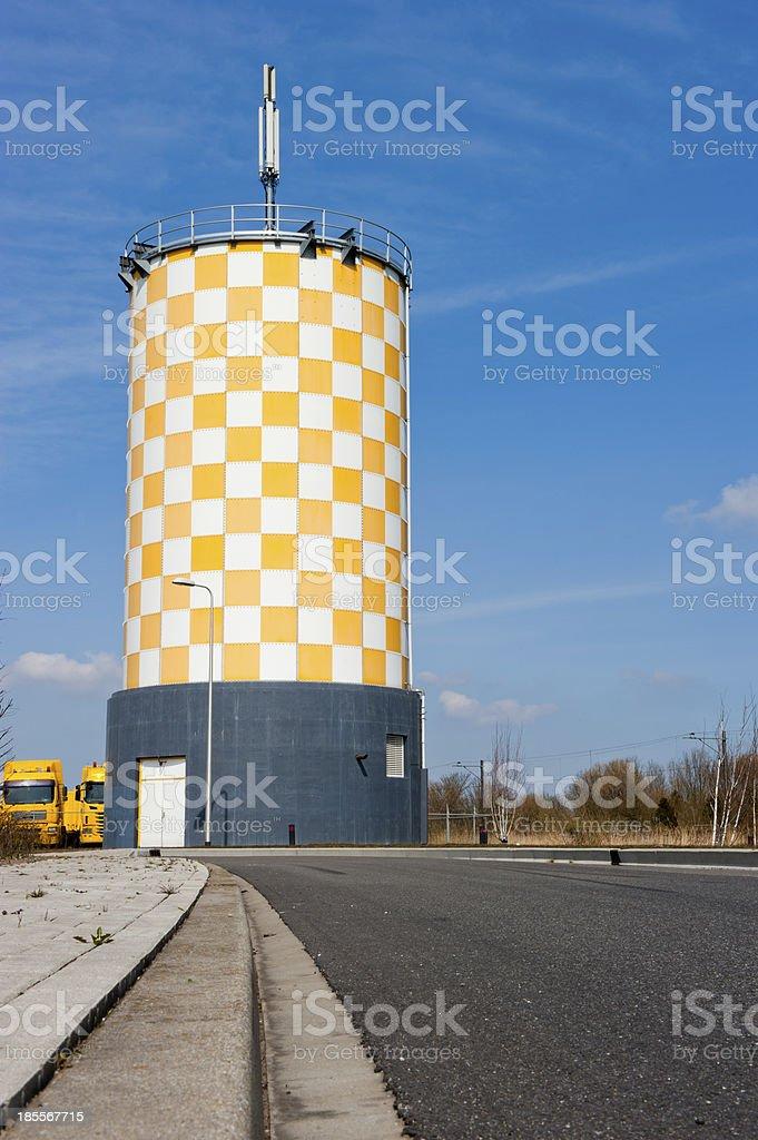 Modern yellow white chequered watertower royalty-free stock photo