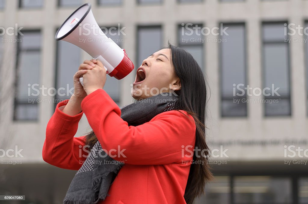 Modern young Chinese woman protesting stock photo