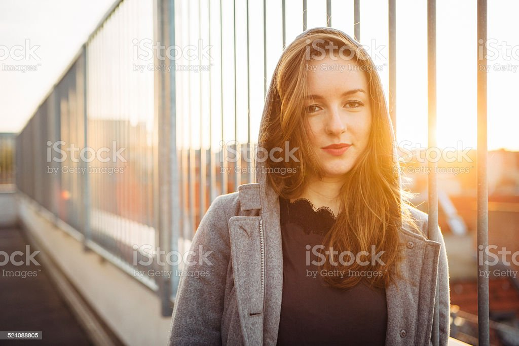 modern young woman portrait in urban scene with back lit stock photo