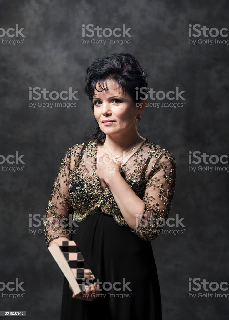 Modern young woman posing in the studio stock photo