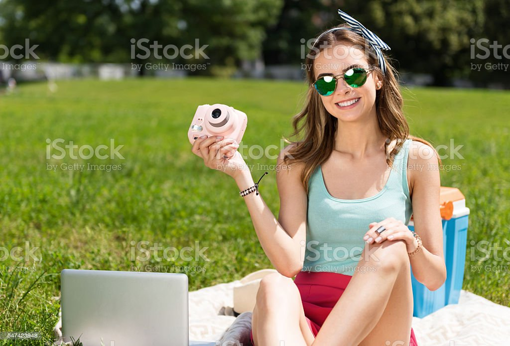 Modern youth relaxing outdoors stock photo