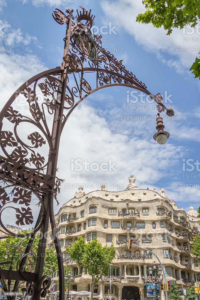Modernist lamppost with Casa Mila in background stock photo