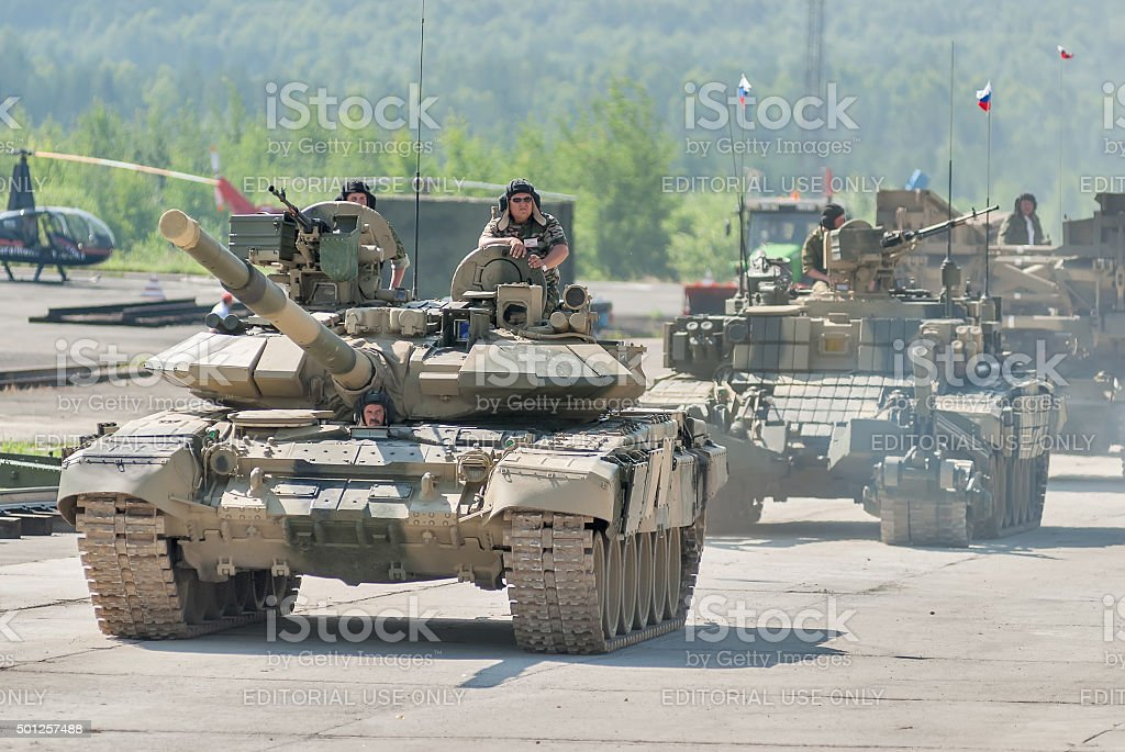 Modernized tank T-72 and convoy in motion. Russia stock photo