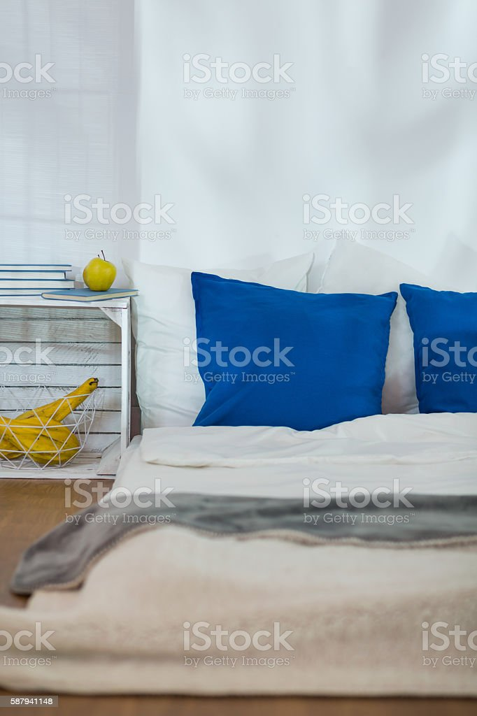 Modest bedroom with mattress as a bed stock photo