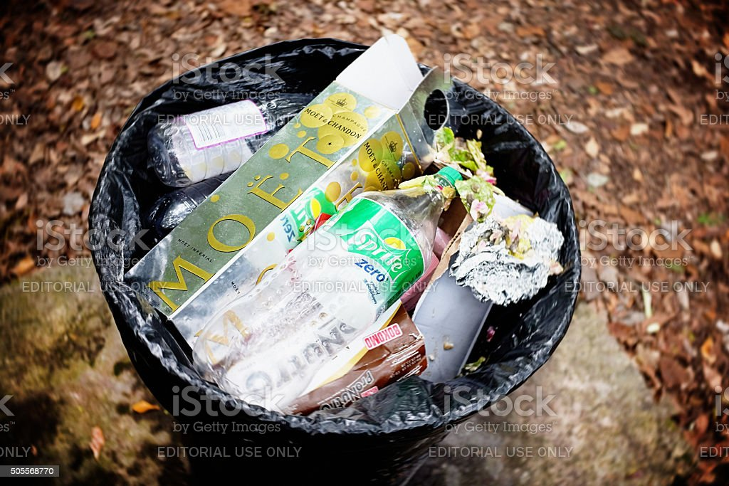 Moet et Chandon champagne carton discarded in trash can stock photo