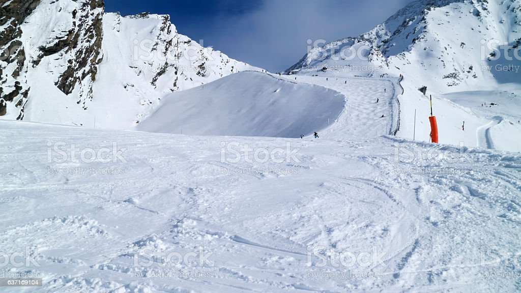 Mogul slope with fresh snow in high mountains stock photo