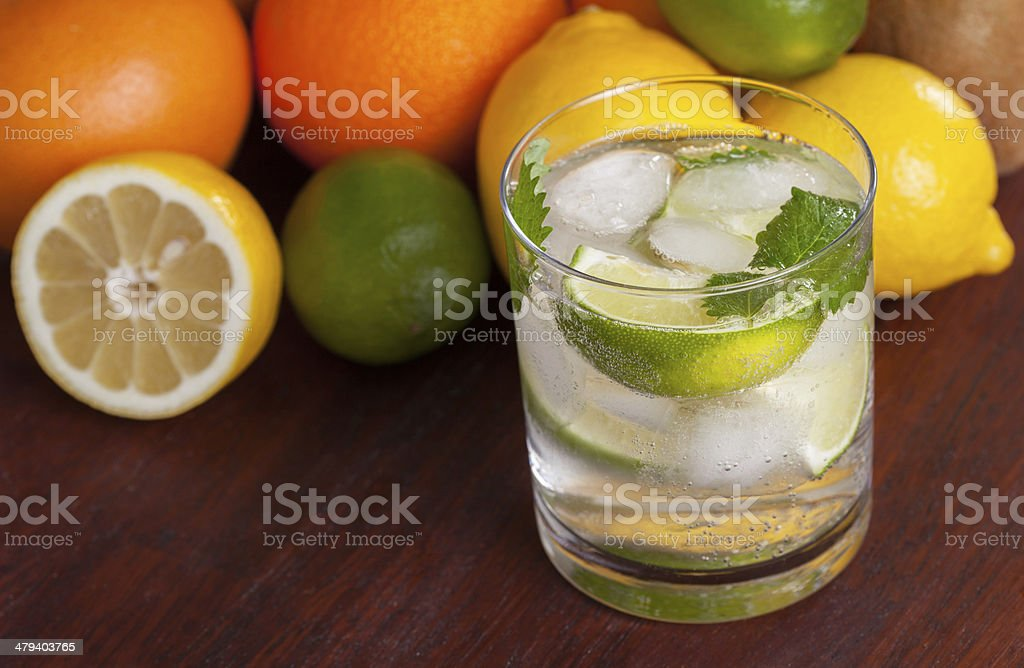 Mohito cocktail surrounded by fruit royalty-free stock photo