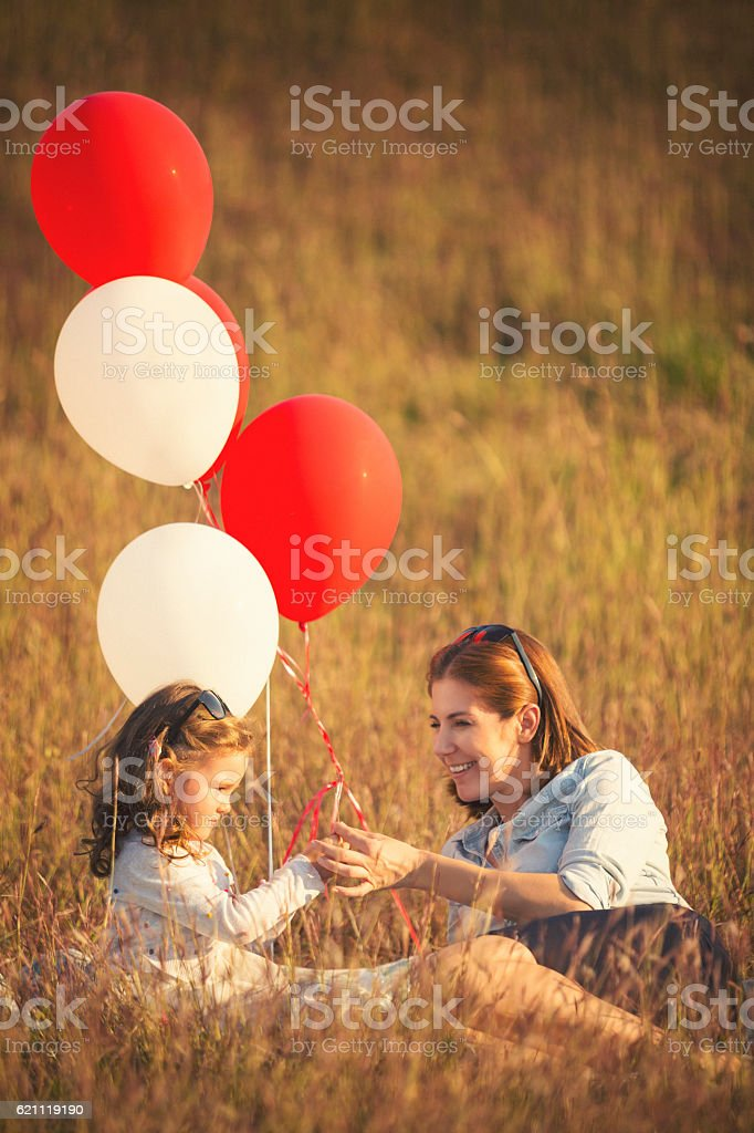 Mohter and her baby girl enjoying the day in nature stock photo