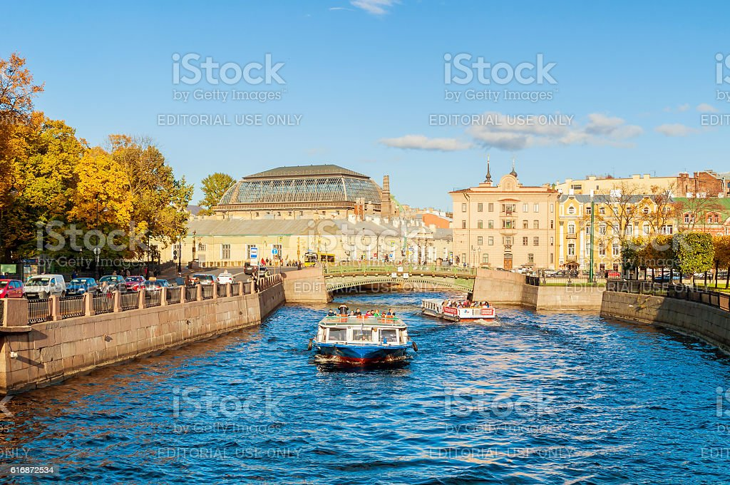 Moika river -  buildings and touristic boat in St Petersburg stock photo