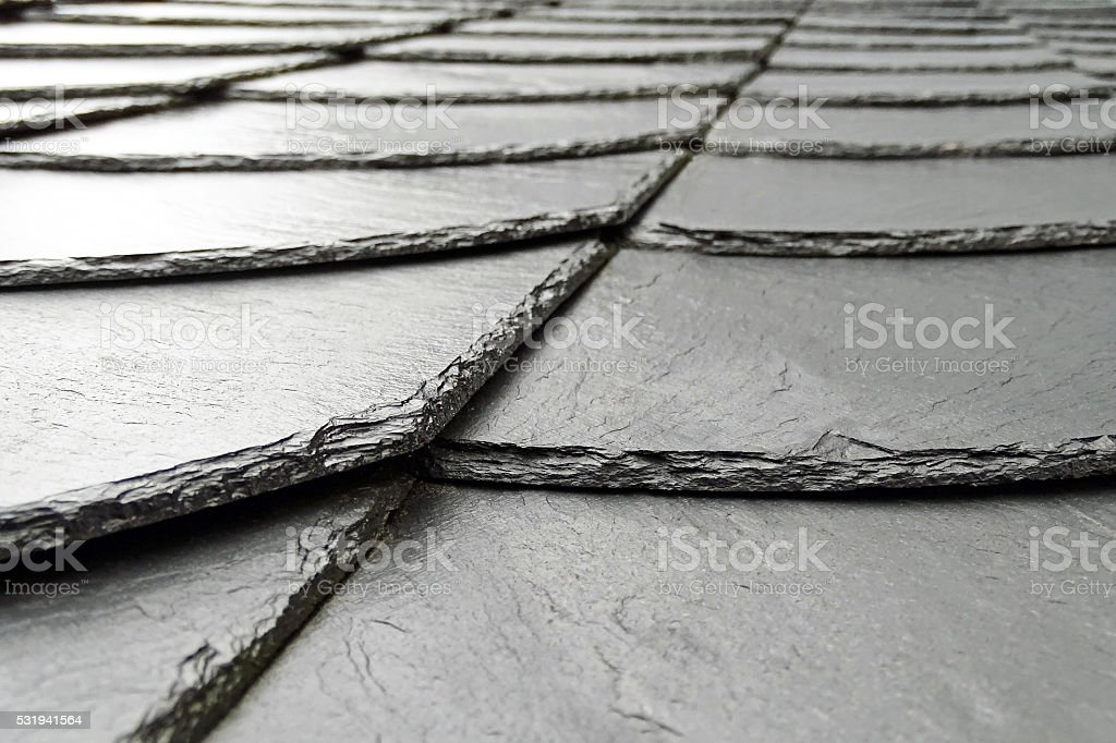 Moist slate roof stock photo