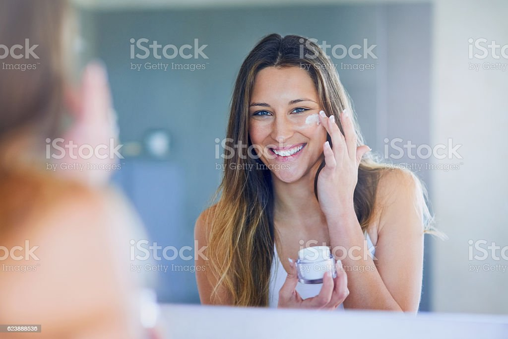 I moisturize daily for soft, smooth skin stock photo