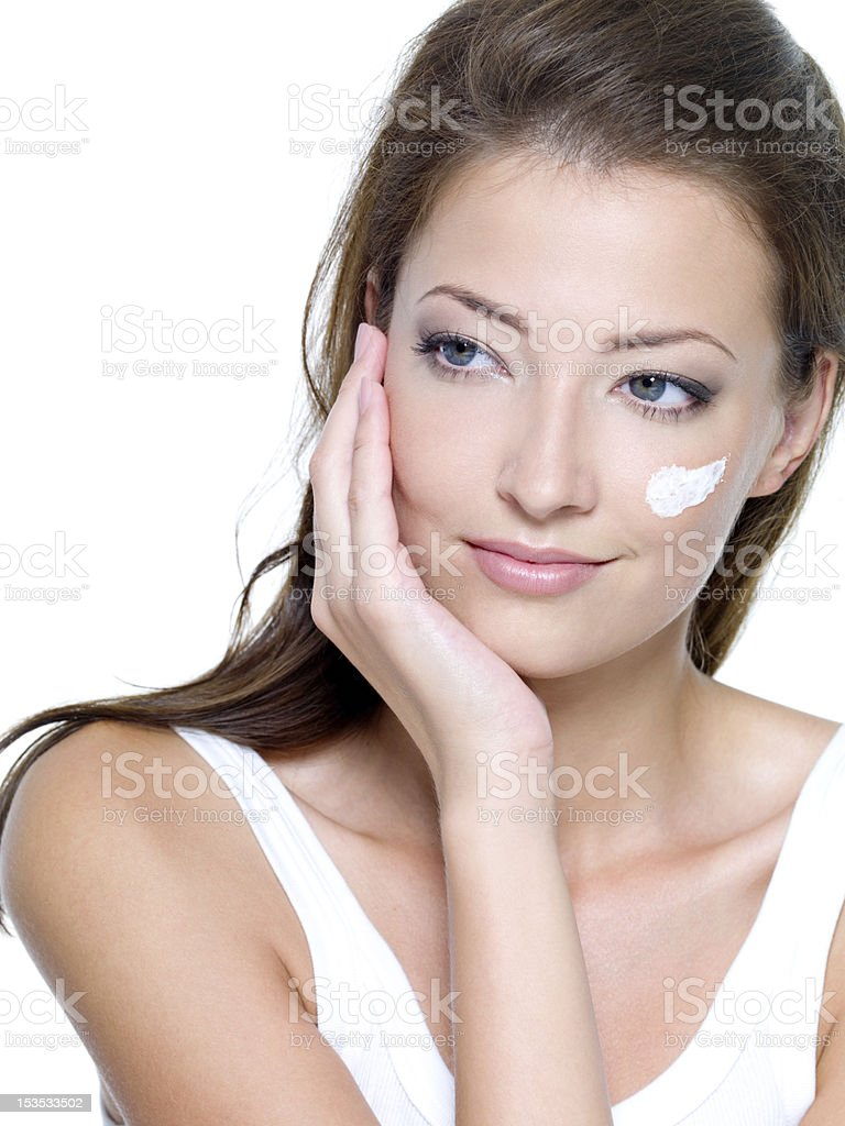 moisturizer cosmetic cream on female face royalty-free stock photo