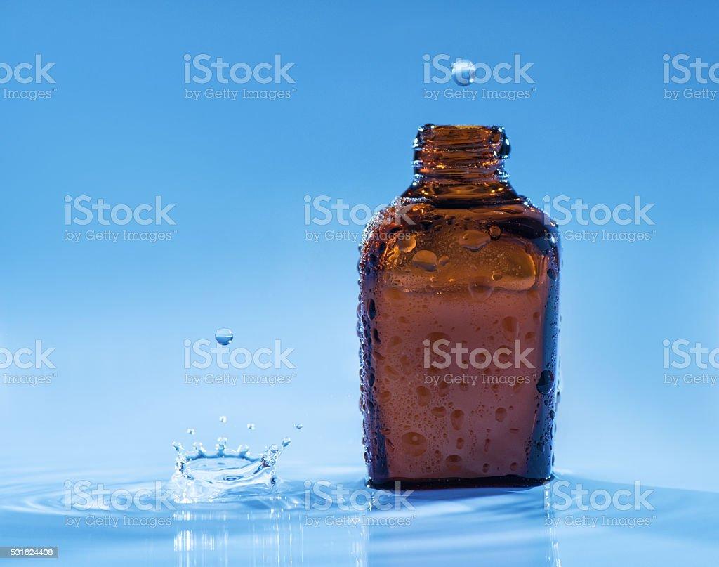 Moisturizing anti-age serum on the blue water background stock photo