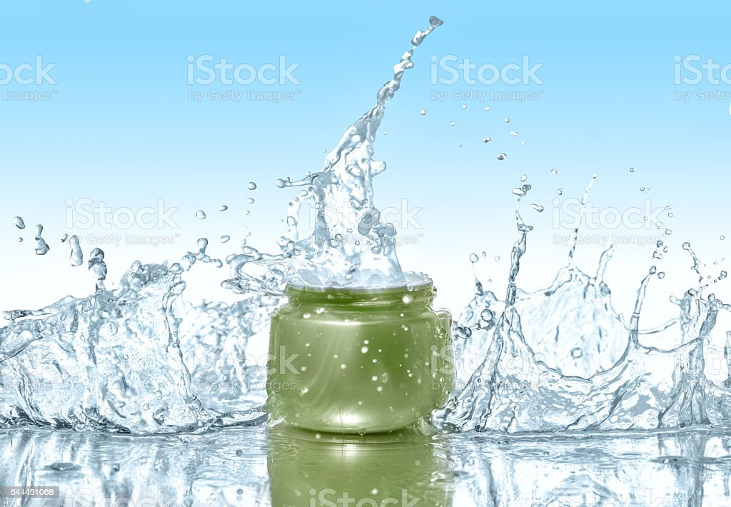 Moisturizing cream in the big water splashes stock photo