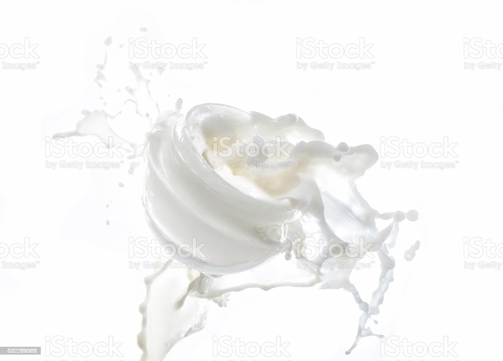 Moisturizing cream, moisturizing milk in the big milk splash stock photo