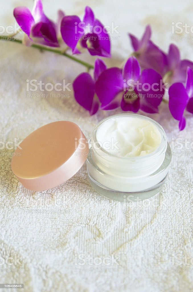 moisturizing cream with purple orchids royalty-free stock photo
