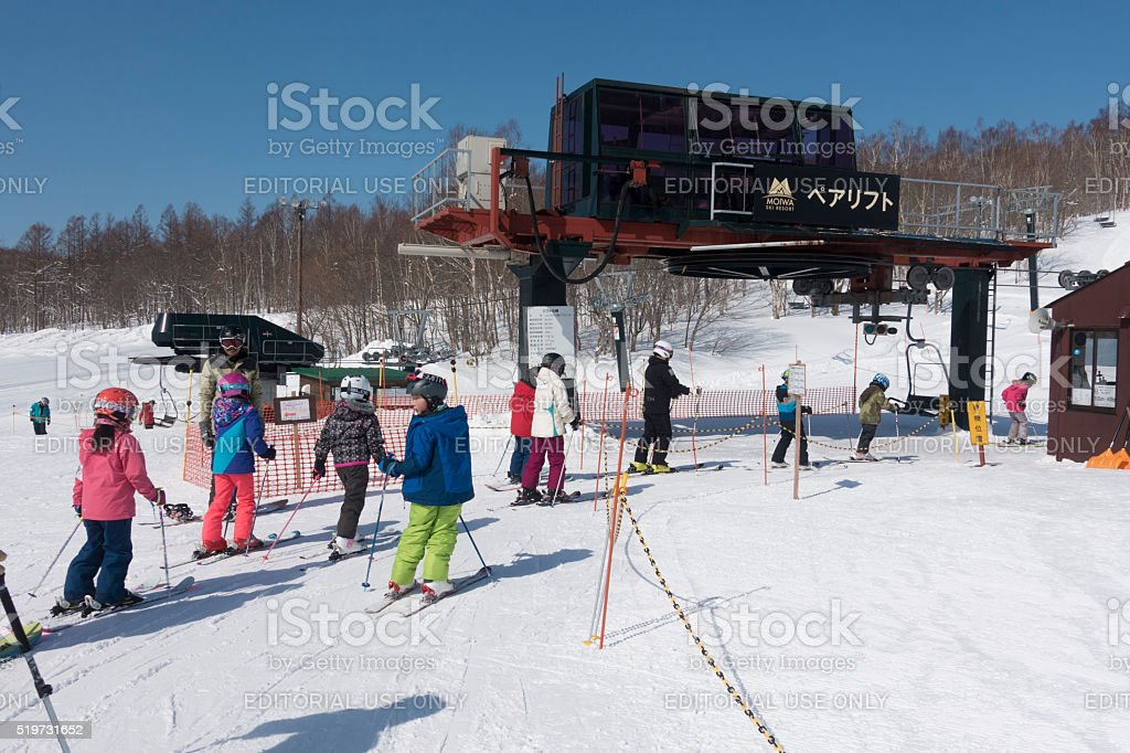 Moiwa Ski Resort Group of Skiers in Lift Line stock photo