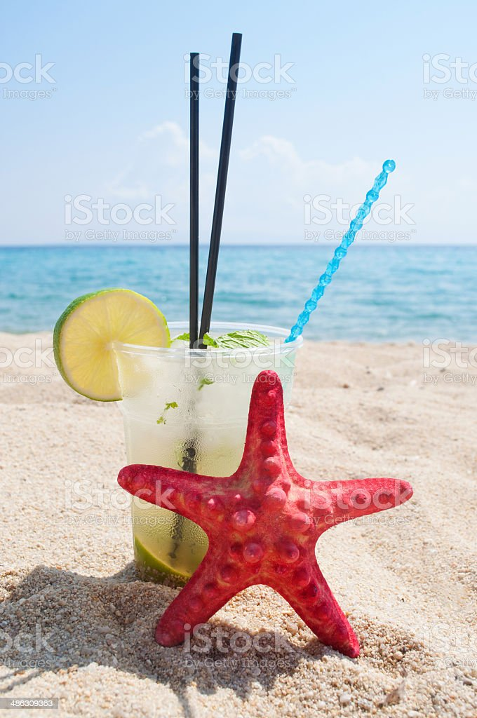 Mojito and red starfish on the beach stock photo