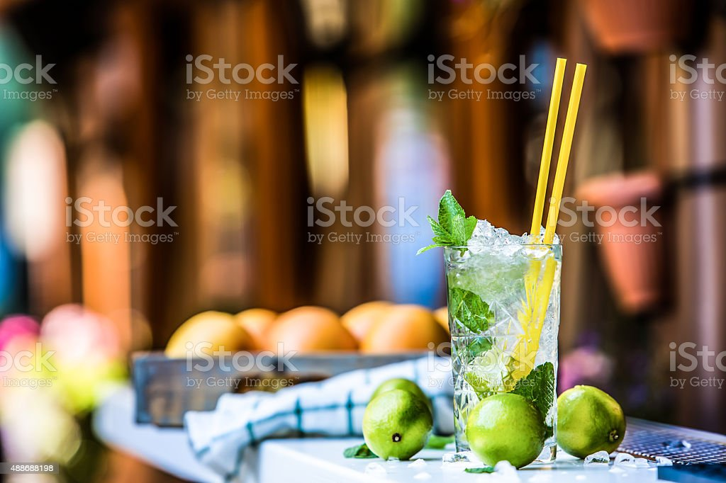 Mojito cocktail. Cocktail glass on the bar counter outdoors stock photo