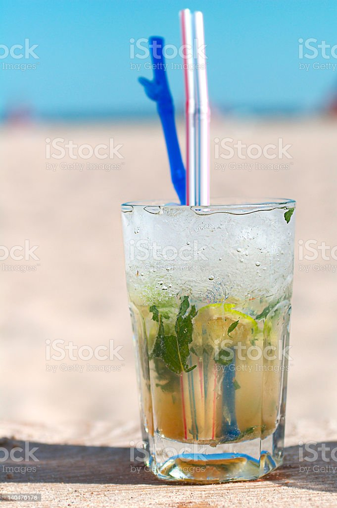 Mojito cocktail on a beach royalty-free stock photo