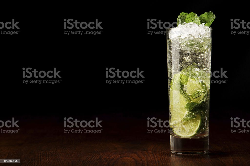 Mojito cocktail on a wooden table stock photo