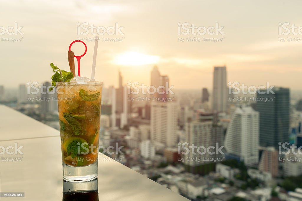 Mojito cocktail on table in rooftop bar with Bangkok city stock photo