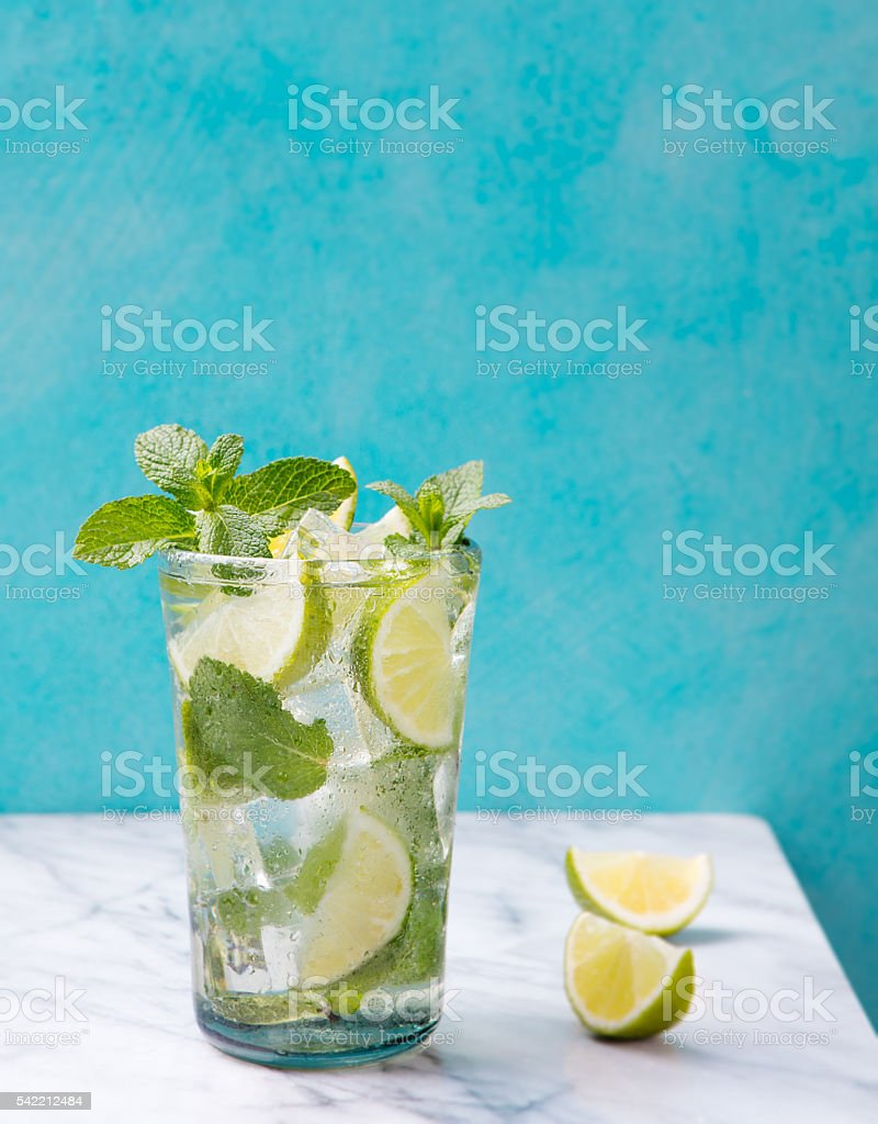 Mojito cocktail with lime and mint on marble table stock photo
