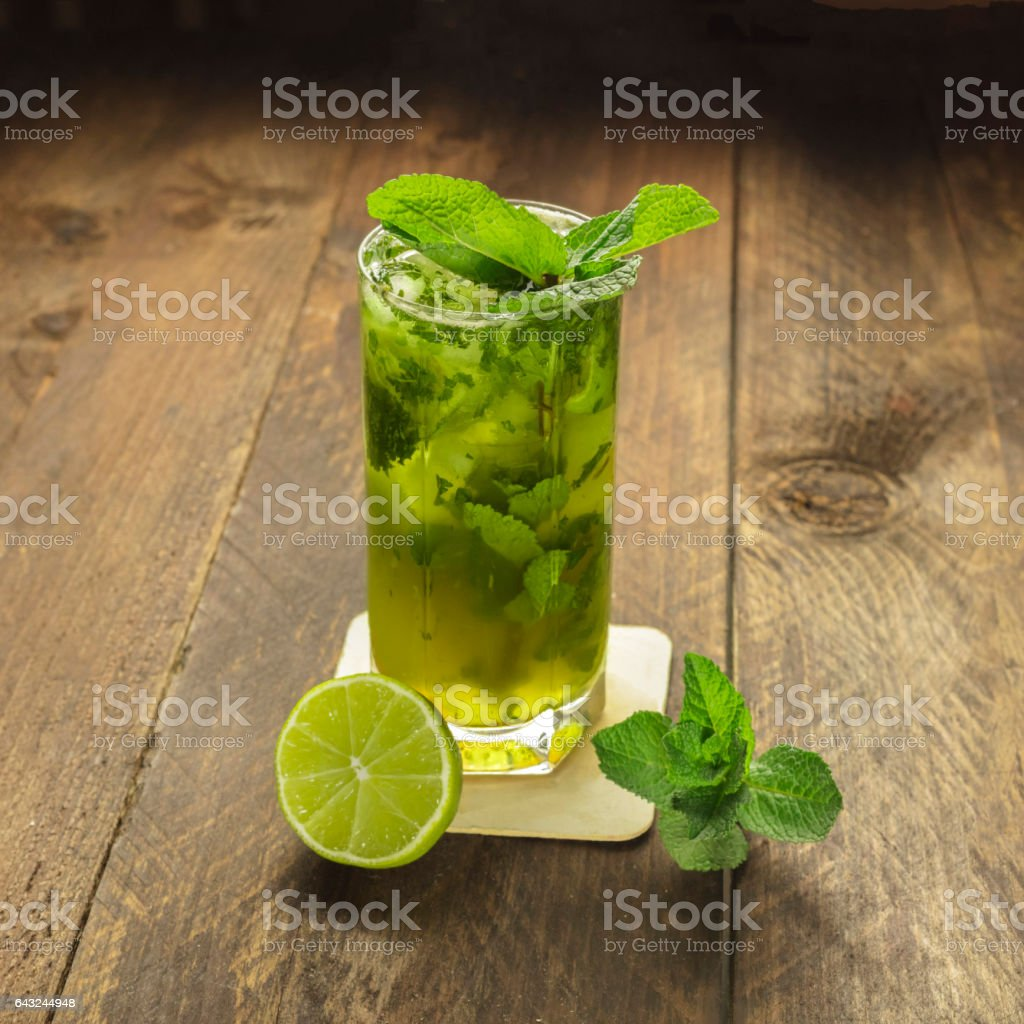 Mojito cocktail with mint leaves and lime stock photo