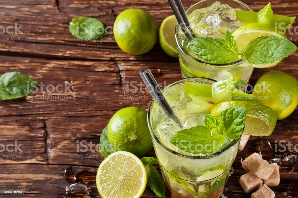 Mojito drinks on wooden planks stock photo