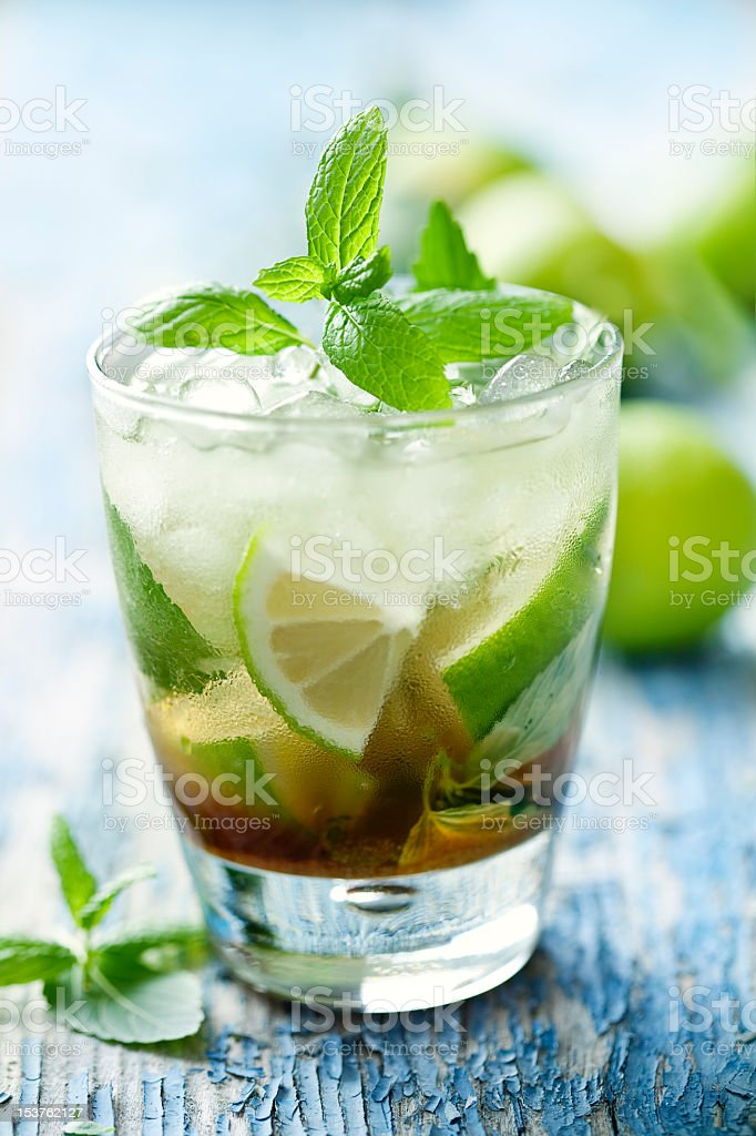 Mojito with ice and lime and a mint garnish stock photo