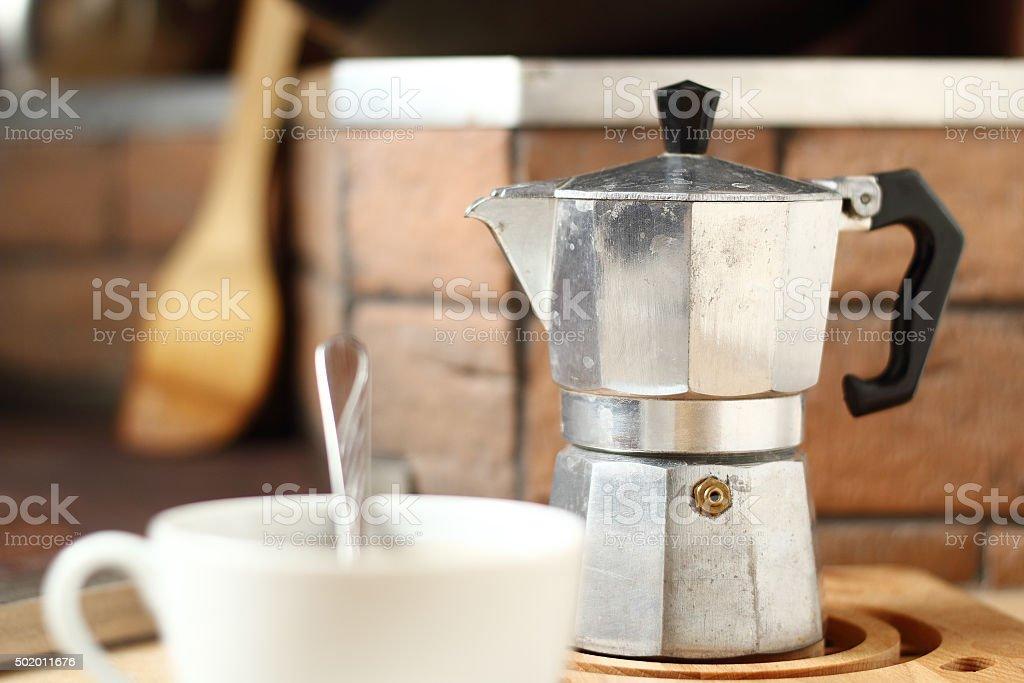 Moka pot and coffee cup stock photo