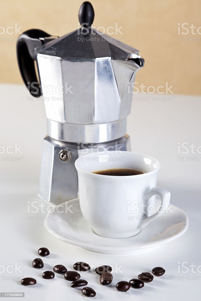 Moka pot and cup of espresso coffee royalty-free stock photo