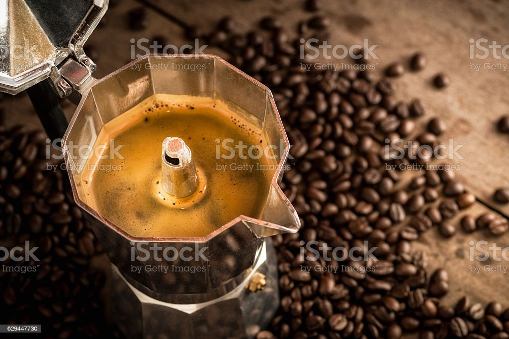 Moka pot old coffee maker and coffee beans stock photo