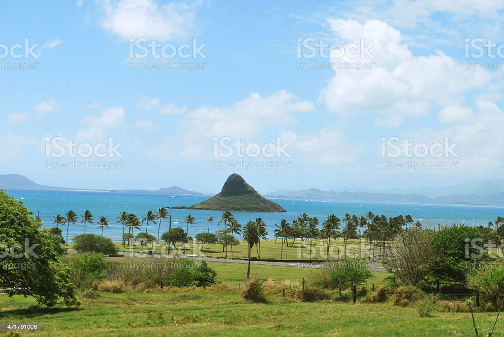 Mokolii islet or Chinaman's Hat in Oahu Island. stock photo