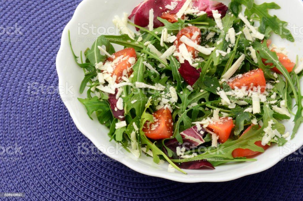 Moldavian salad with arugula cherry tomatoes and cheese stock photo