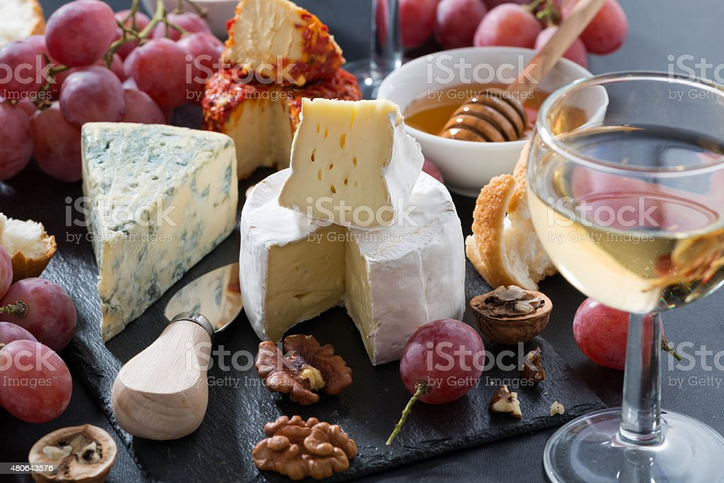 molded cheeses, wine and snacks stock photo