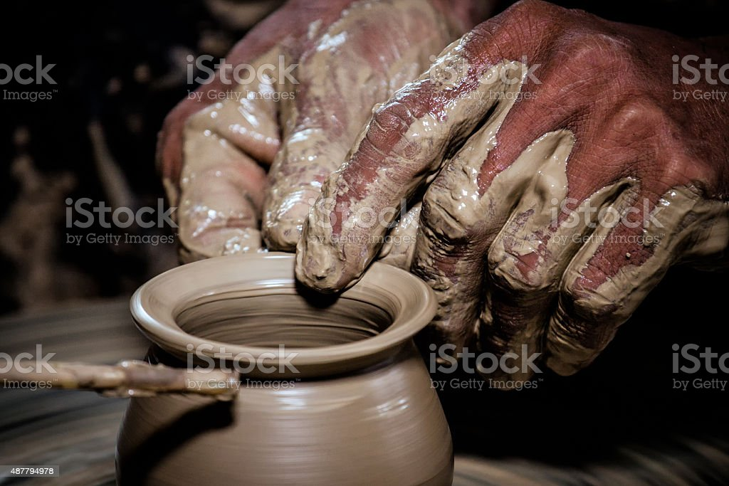 Molding clay pots by hand stock photo