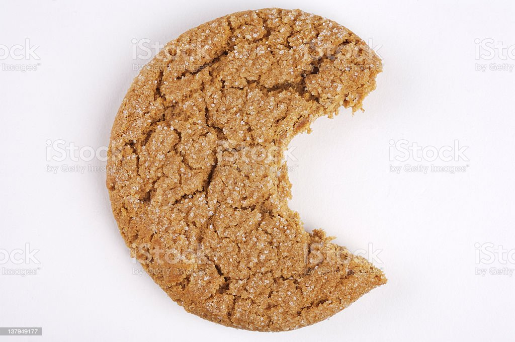 Mollasses cookie with a bite gone stock photo
