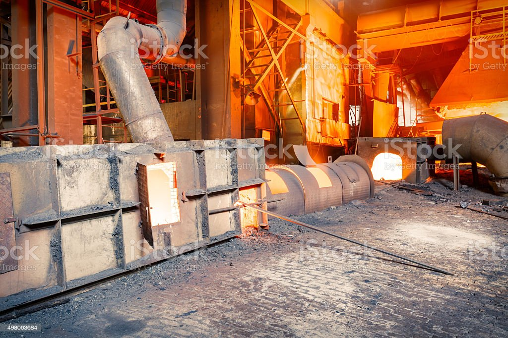 Molten iron smelting furnace in Steel mills stock photo