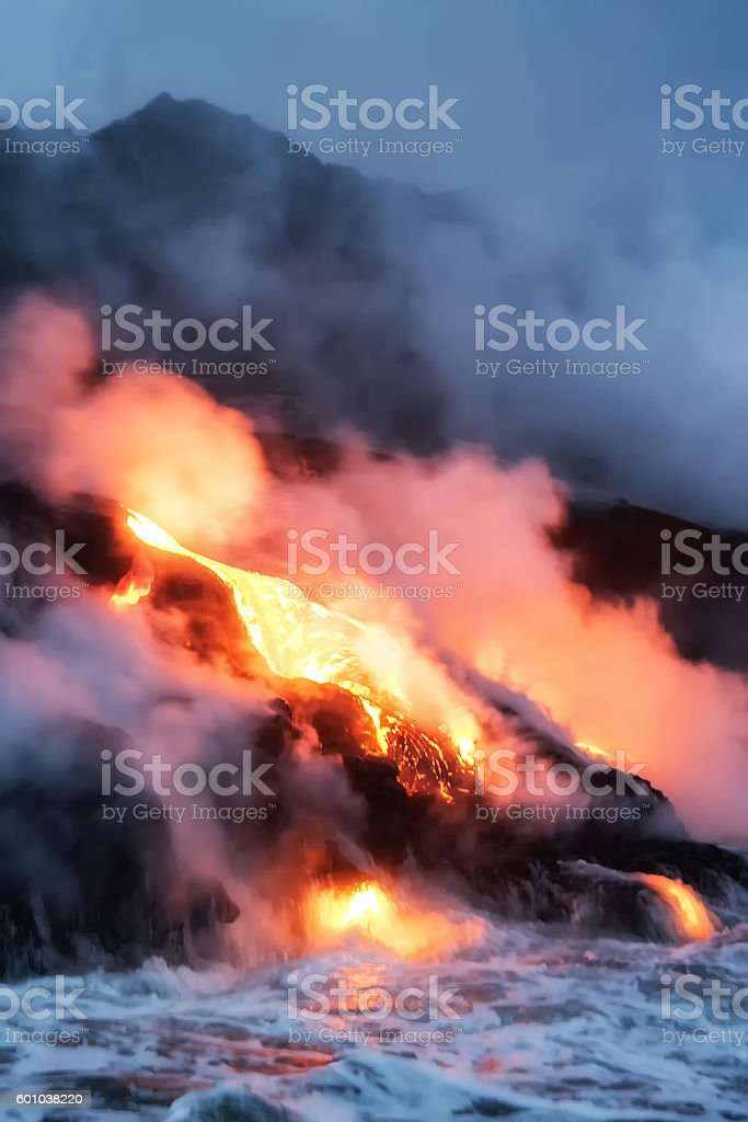 Molten lava flowing into the Pacific Ocean stock photo